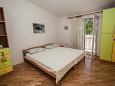 Bedroom 2 - Apartment A-10014-d - Apartments Mali Rat (Omiš) - 10014