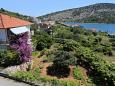 Courtyard Vinišće (Trogir) - Accommodation 10241 - Apartments near sea with pebble beach.