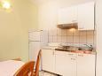 Kitchen - Apartment A-10323-b - Apartments Pisak (Omiš) - 10323