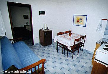 Seget Vranjica, Dining room u smještaju tipa apartment.