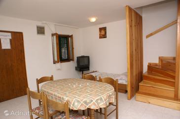 Kanica, Dining room u smještaju tipa apartment.