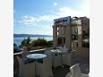 Courtyard Nemira (Omiš) - Accommodation 11340 - Rooms near sea with pebble beach.