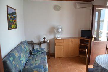 Stara Novalja, Living room u smještaju tipa apartment, dostupna klima.