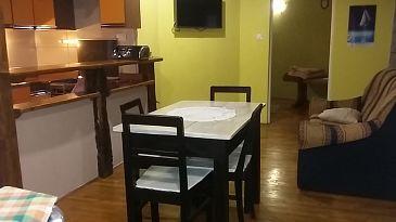 Veli Mlun, Jídelna u smještaju tipa apartment, dostupna klima, dopusteni kucni ljubimci i WIFI.