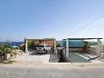 Parking lot Milna (Vis) - Accommodation 2461 - Apartments near sea with rocky beach.