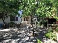 Courtyard Podgora (Makarska) - Accommodation 316 - Apartments near sea with pebble beach.