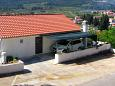 Parking lot Jelsa (Hvar) - Accommodation 4595 - Apartments with pebble beach.