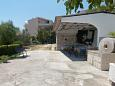 Courtyard Duće (Omiš) - Accommodation 4798 - Apartments near sea with sandy beach.