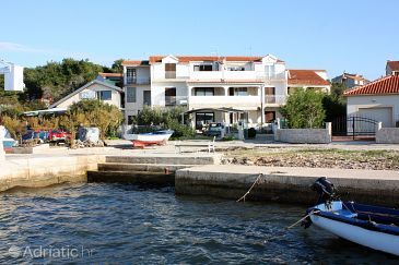 Property Brodarica (Šibenik) - Accommodation 4832 - Apartments near sea with pebble beach.