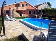 Property Zemunik Donji (Zadar) - Accommodation 6188 - Apartments with pebble beach.