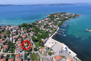 Property Sukošan (Zadar) - Accommodation 6229 - Apartments near sea with pebble beach.