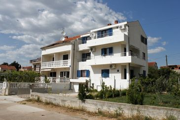 Property Biograd na Moru (Biograd) - Accommodation 6270 - Apartments with pebble beach.