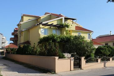 Property Novalja (Pag) - Accommodation 6399 - Apartments with pebble beach.