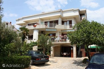 Property Novalja (Pag) - Accommodation 6419 - Apartments with pebble beach.