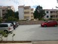 Novalja, Pag, Parking lot 6489 - Apartments blizu mora with pebble beach.