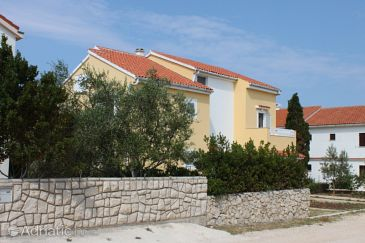 Property Novalja (Pag) - Accommodation 6550 - Apartments with pebble beach.