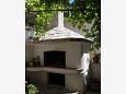 Courtyard Podgora (Makarska) - Accommodation 6774 - Apartments near sea with pebble beach.