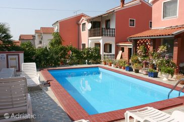 Property Cancini (Poreč) - Accommodation 7010 - Apartments with pebble beach.