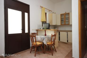 Mali Lošinj, Dining room u smještaju tipa studio-apartment, dopusteni kucni ljubimci i WIFI.