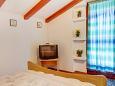 Mali Lošinj, Bedroom u smještaju tipa studio-apartment, dostupna klima i WIFI.
