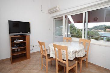 Verunić, Dining room u smještaju tipa apartment, dostupna klima i dopusteni kucni ljubimci.