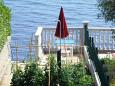 Courtyard Tkon (Pašman) - Accommodation 8244 - Apartments near sea with pebble beach.