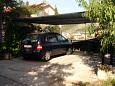Parking lot Seget Vranjica (Trogir) - Accommodation 8623 - Apartments with pebble beach.