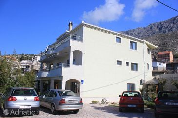 Property Dugi Rat (Omiš) - Accommodation 8667 - Apartments with pebble beach.