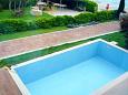 Courtyard Podstrana (Split) - Accommodation 9466 - Vacation Rentals near sea with pebble beach.